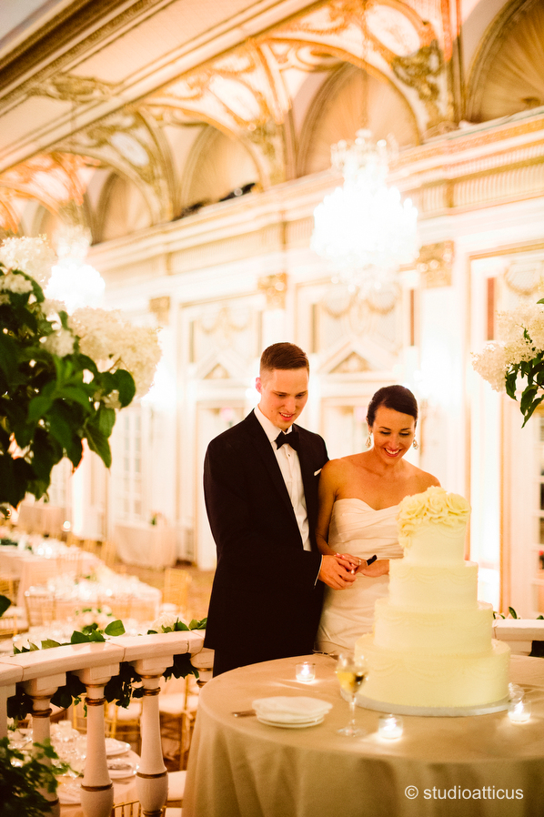 bride and groom cut the cake at a boston fairmont copley plaza wedding reception
