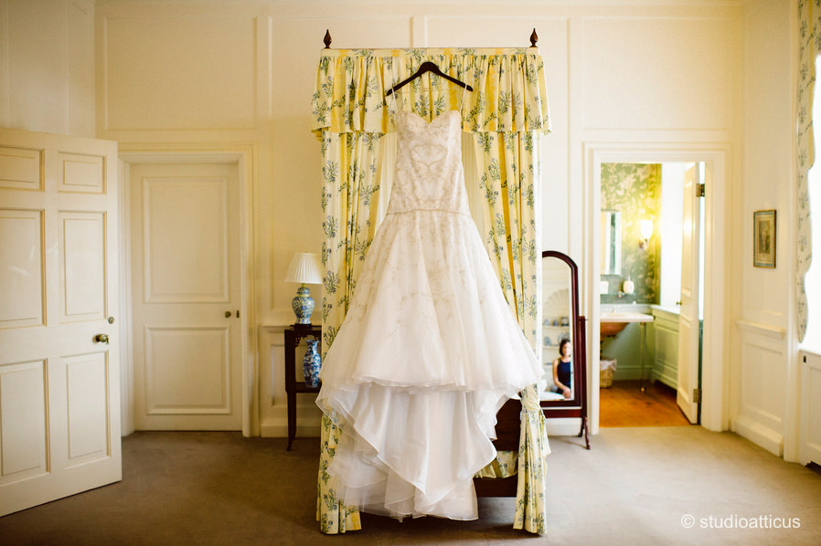 wedding gown hangs in the bridal suite at the Crane Estate