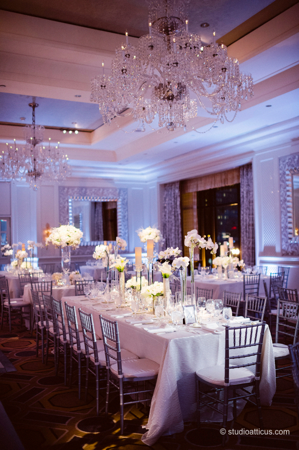 The Boston Four Seasons Hotel ballroom, dressed in white for a wedding reception.