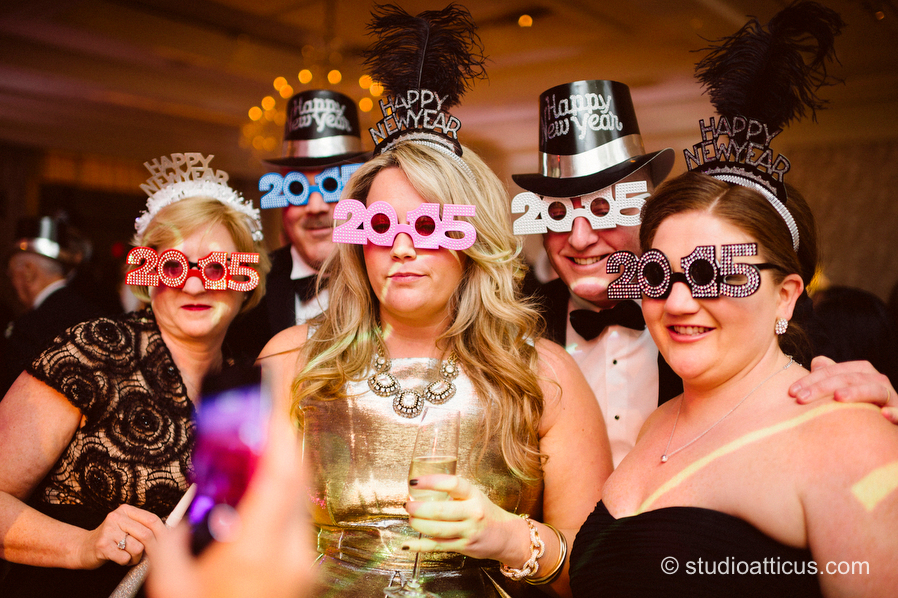 wedding guests don 2015 glasses to welcome in the New Year at the Four Seasons Hotel in Boston