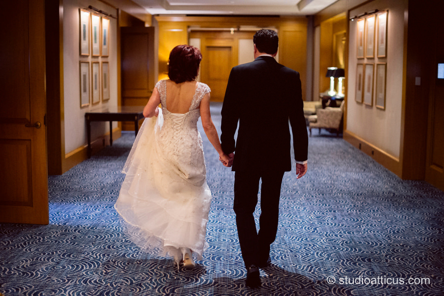 The bride and groom spend time together prior to the Boston Four Seasons Hotel wedding