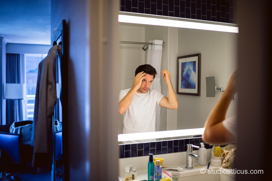 the groom prepares at the Royal Sonesta for his Museum of Science wedding