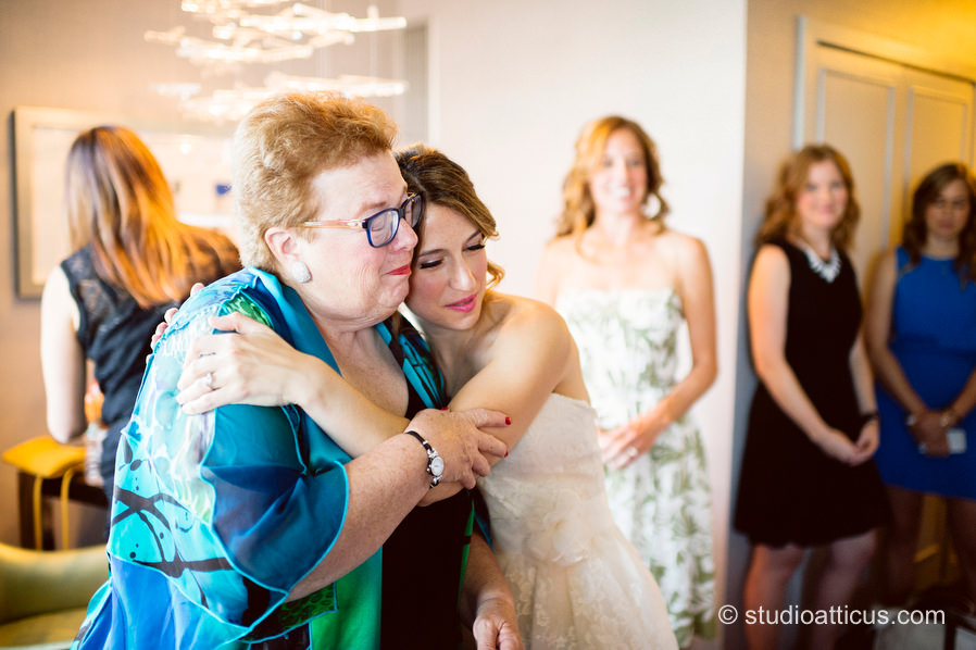 The bride and her mother embrace before her wedding at the Museum of Science