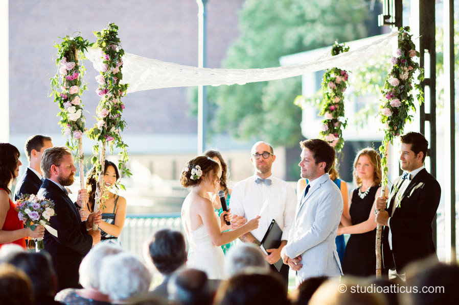 The couple says their vows under a beautiful chuppah at a Museum of Science wedding ceremony