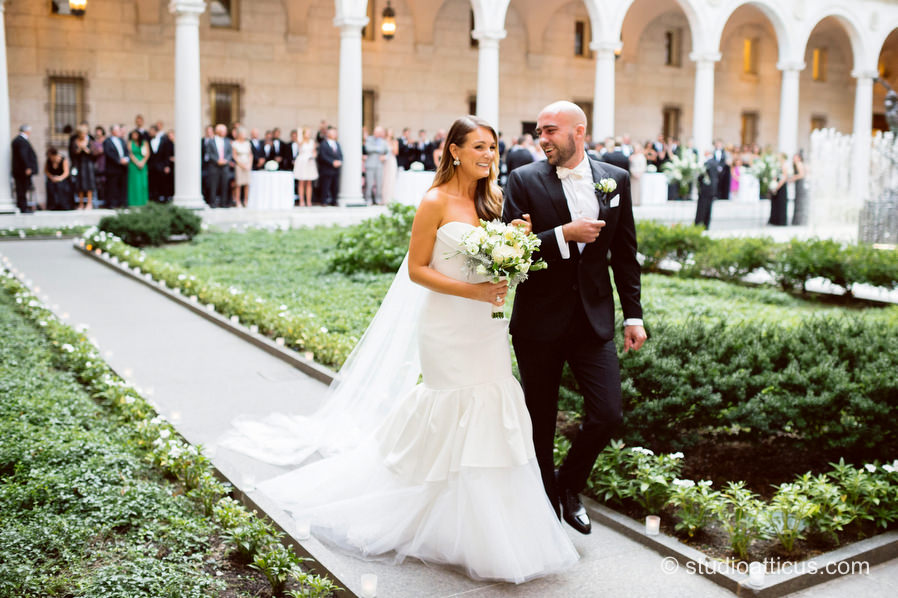 The happy couple after the ceremony in their Boston Public Library Courtyard wedding