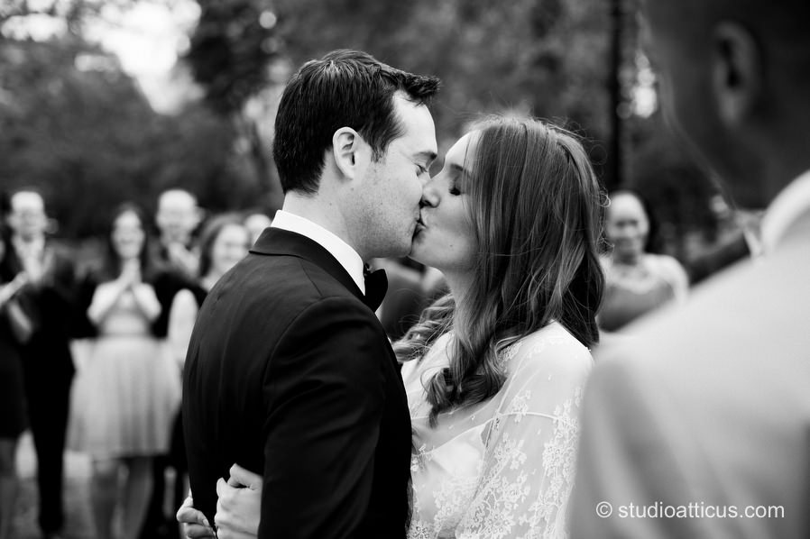 First kiss at a ceremony at the Boston Garden prior to their Menton wedding reception.