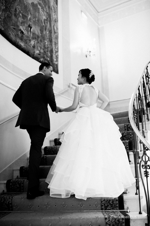 The couple on the staircase at a wedding in the Taj hotel in Boston